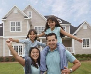 Fam of 4 in front of house